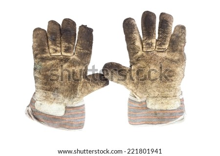 A pair of dirty working glove palms on white background - stock photo