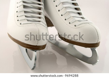 A pair of elegant white figure skates. - stock photo