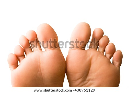 a pair of female feet isolated - stock photo