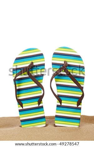 A pair of flipflops or beach sandals with copy space on a white background. Shallow depth of field - stock photo