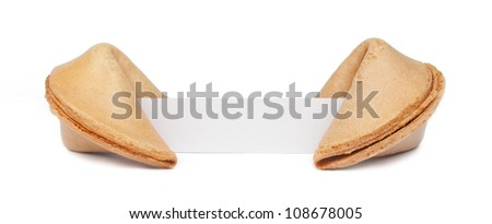 A pair of fortune cookies with a blank piece of paper isolated on white. - stock photo