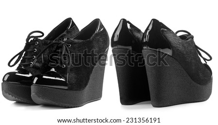 A pair of fur shoe on high wedge heels isolated on white background. Front view, rear view - stock photo