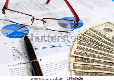 A pair of glasses on top of a financial report.