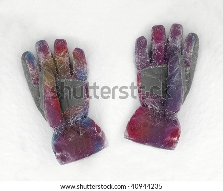 A pair of gloves on the fresh snow - stock photo