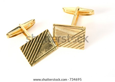 A pair of gold cufflinks - stock photo