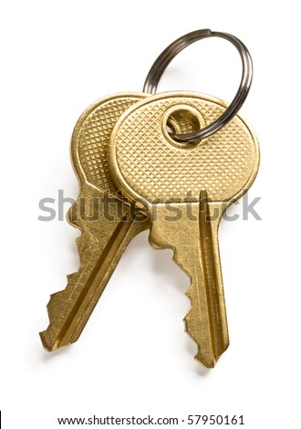 A pair of gold keys isolated on white background. - stock photo