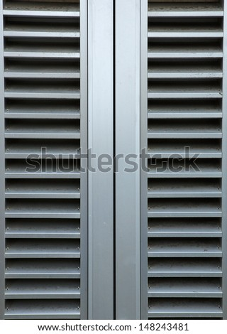 A pair of gray Steel vents on a building wall - stock photo
