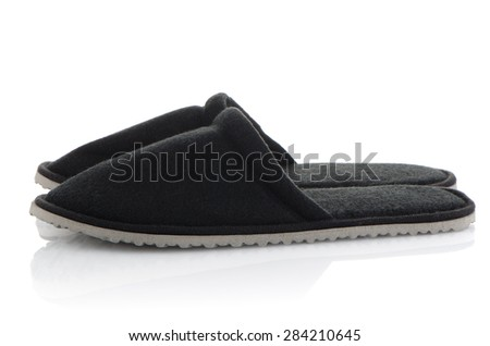 A pair of grey slippers on a white background. - stock photo