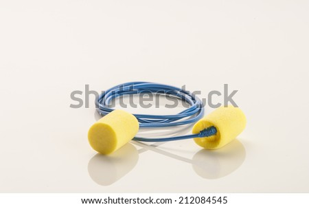 A pair of hearing protection ear plugs on a table - stock photo