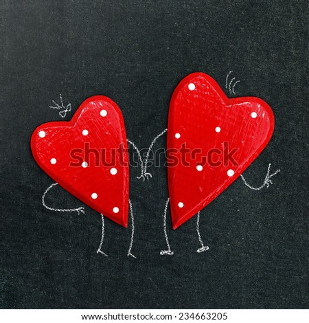 a pair of hearts on a chalk board - stock photo