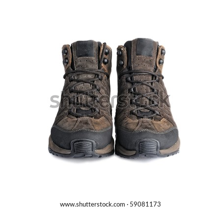 A pair of hiking boots isolated on white background. - stock photo