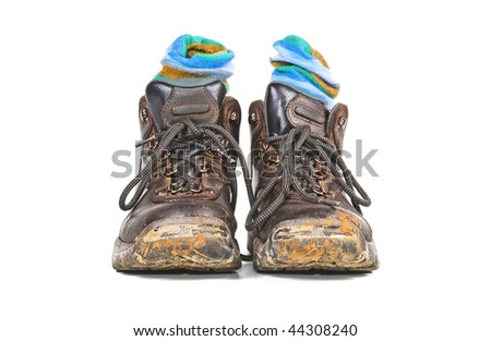 a Pair of hiking boots with blue socks on a white background with space for text - stock photo