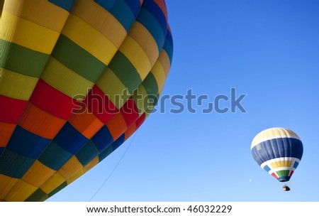 A pair of hot balloons in the air. - stock photo