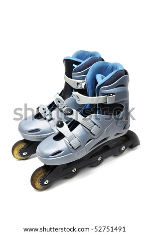 a pair of inline skates isolated on a white background - stock photo