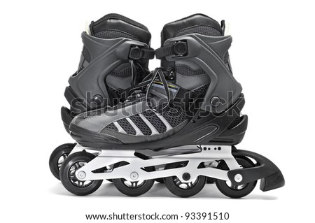 a pair of inline skates on a white background - stock photo