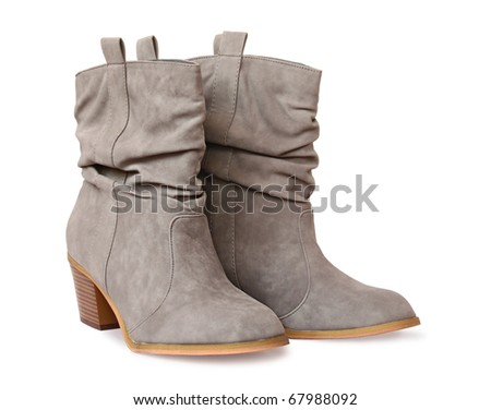 A pair of isolated female gray boots on white background.