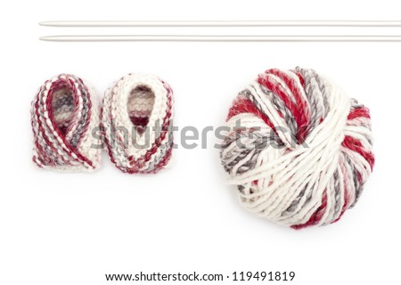 A pair of knitted baby booties on white background - stock photo