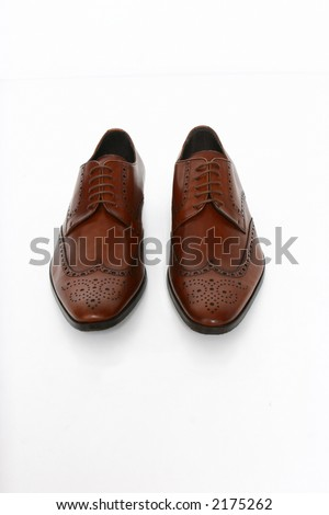 a pair of male brown shoes