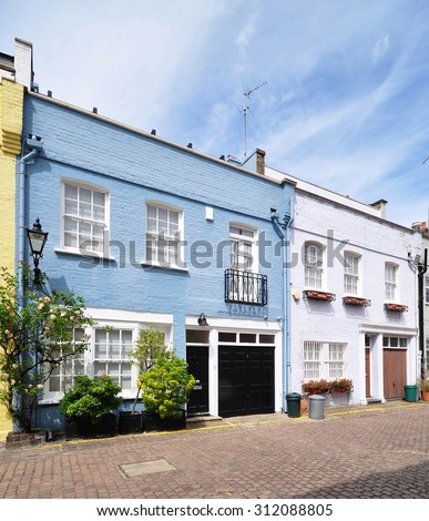 A pair of mews houses converted from 18th century stable carriage buildings, in Kensington, London, UK. - stock photo