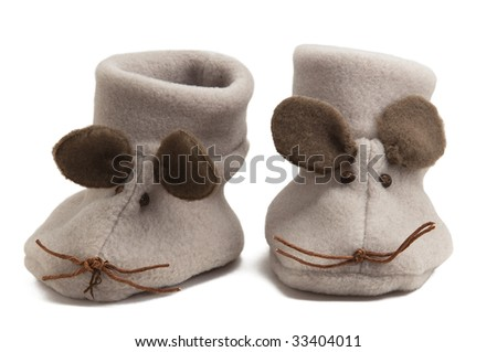 A pair of mouse baby shoes isolated on white background. - stock photo