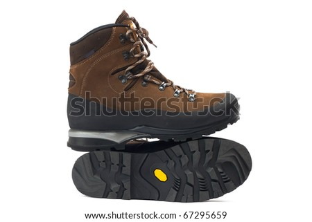 A pair of new hiking boots on white background - stock photo