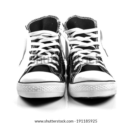 a pair of new sneakers isolated on white - stock photo