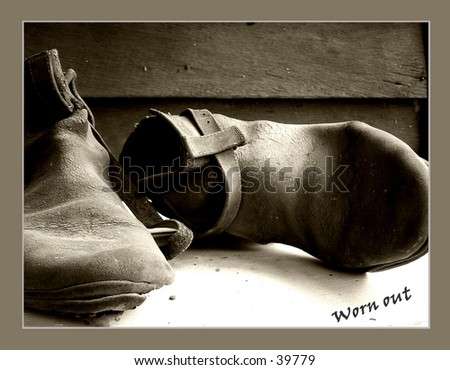 a pair of old boots - stock photo