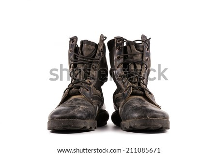 A pair of old combat boots isolated on white background. - stock photo