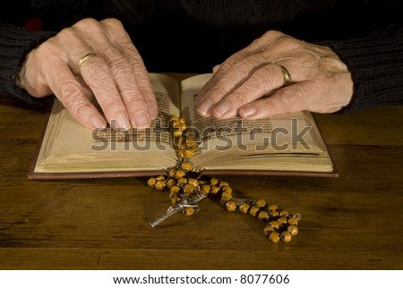 a pair of old hands while reading the old bible
