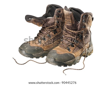 A pair of old hiking boots isolated on white background - stock photo