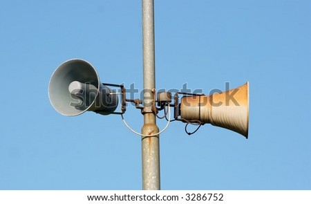 A pair of old loudspeakers at a railway station - stock photo