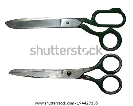 a pair of old scissors on a white background