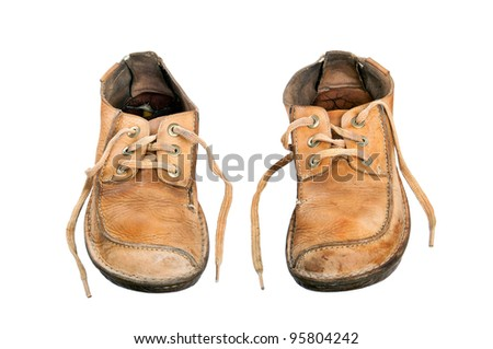 A pair of old, yellow, male shoes. - stock photo