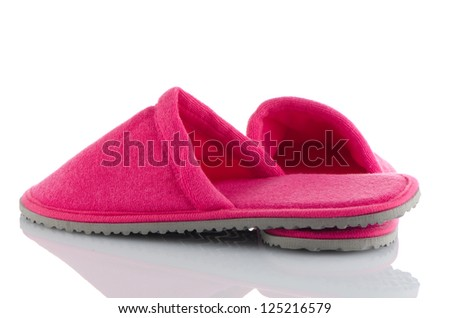 A pair of pink slippers on a white background. - stock photo