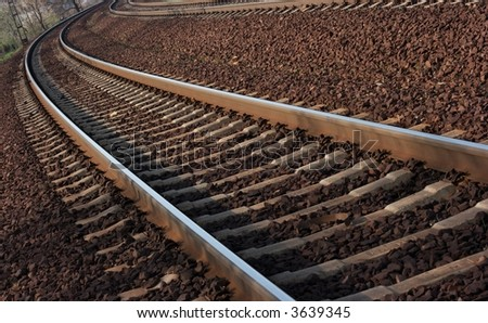 A pair of railway tracks in a bend - stock photo
