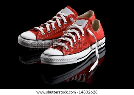 A pair of really cool red canvas sneakers