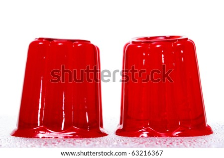 a pair of red gelatins on a white background - stock photo