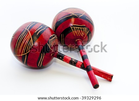 A Pair of red maracas on a white background - stock photo