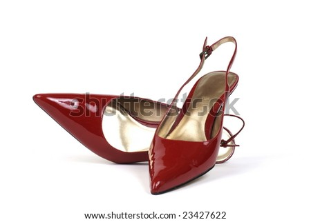 a pair of red women's high-heel dress shoes, one standing, one lying down - stock photo