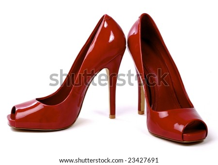 A pair of red women's high-heel shoes against white background - stock photo