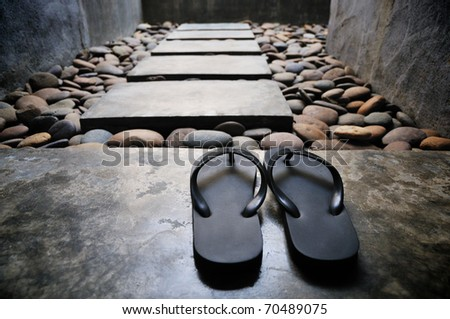 A pair of sandals at bathroom spa entrance - stock photo