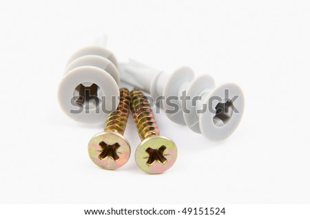 A pair of self drill drywall fixings on a white background - stock photo