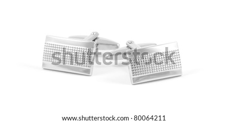 A pair of silver cuff links isolated on a white background. - stock photo