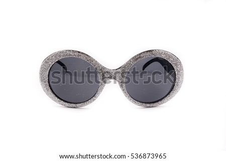 A pair of silver glasses with black lenses isolated on white background. Extravagant party goggles. Carnival accessory. Closeup. Front view