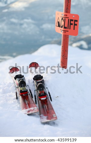 A pair of skis on the edge of a dangerous cliff in Whistler, BC - stock photo