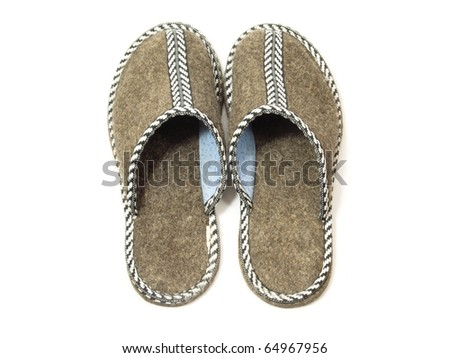 A pair of slipper on white background. - stock photo