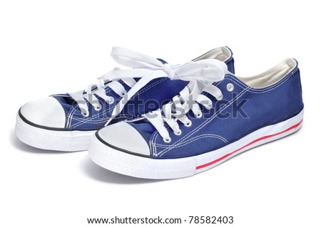 a pair of sneakers on a white background - stock photo