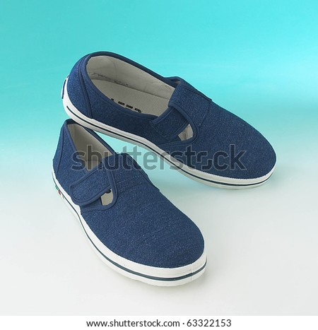 a pair of sneakers on plain background - stock photo
