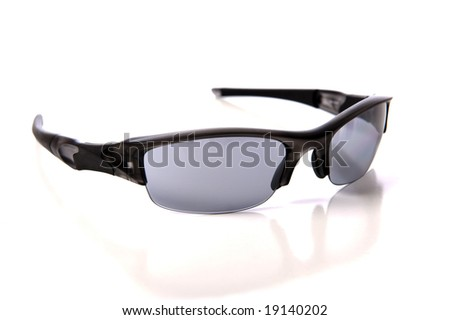 A pair of sports sunglasses or shades on a white background