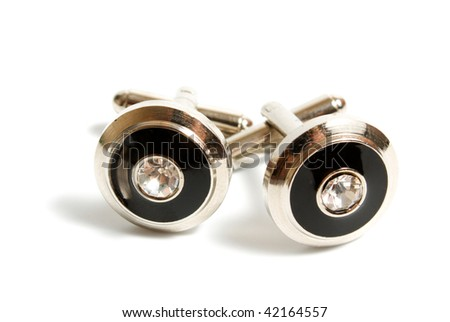 a pair of stainless steel cufflinks on white - stock photo